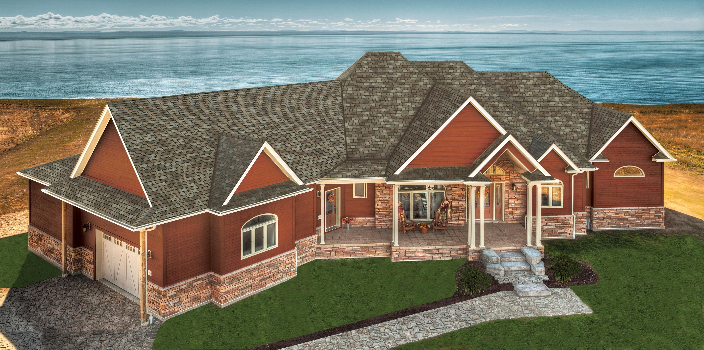 Lake Front house with Terra Cotta siding with Taupe Slate IKO Royal Estate shingles.