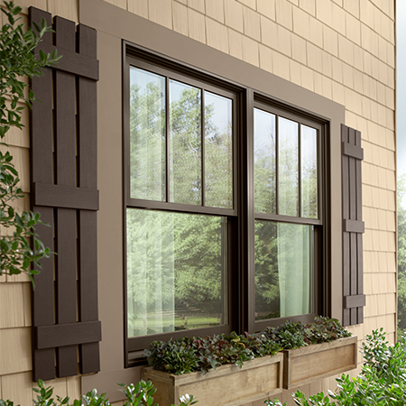Napco shutters 3 panel in board and batten open feature in brown